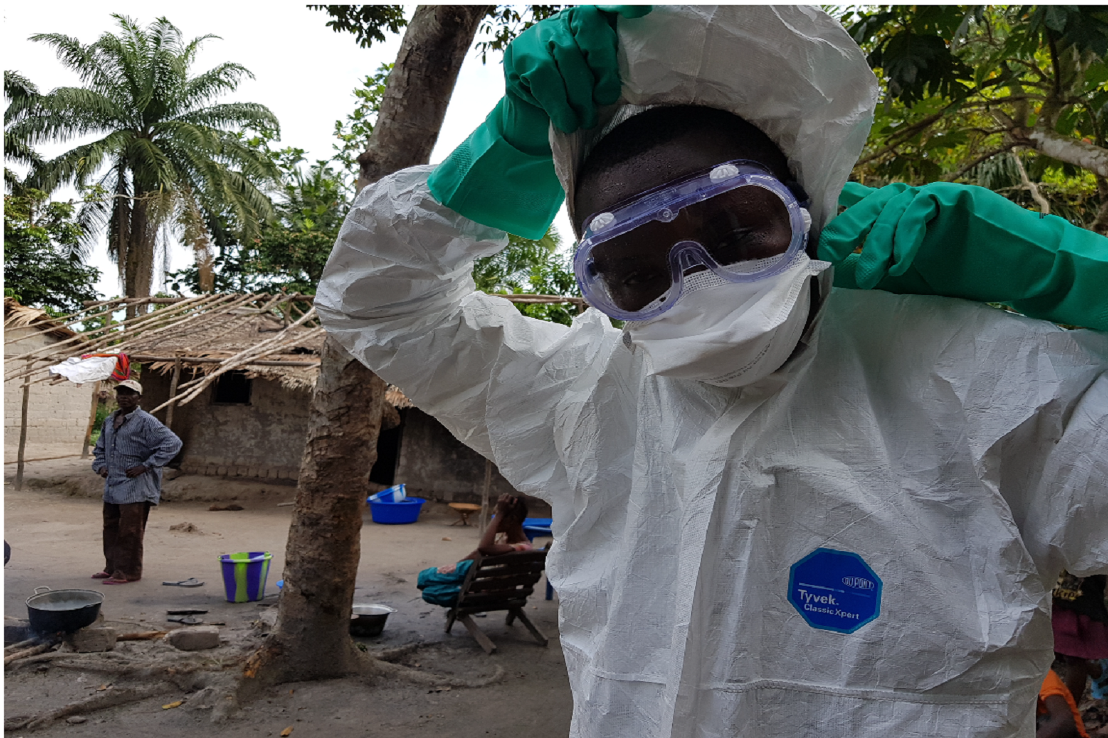 Health worker wearing protective gear