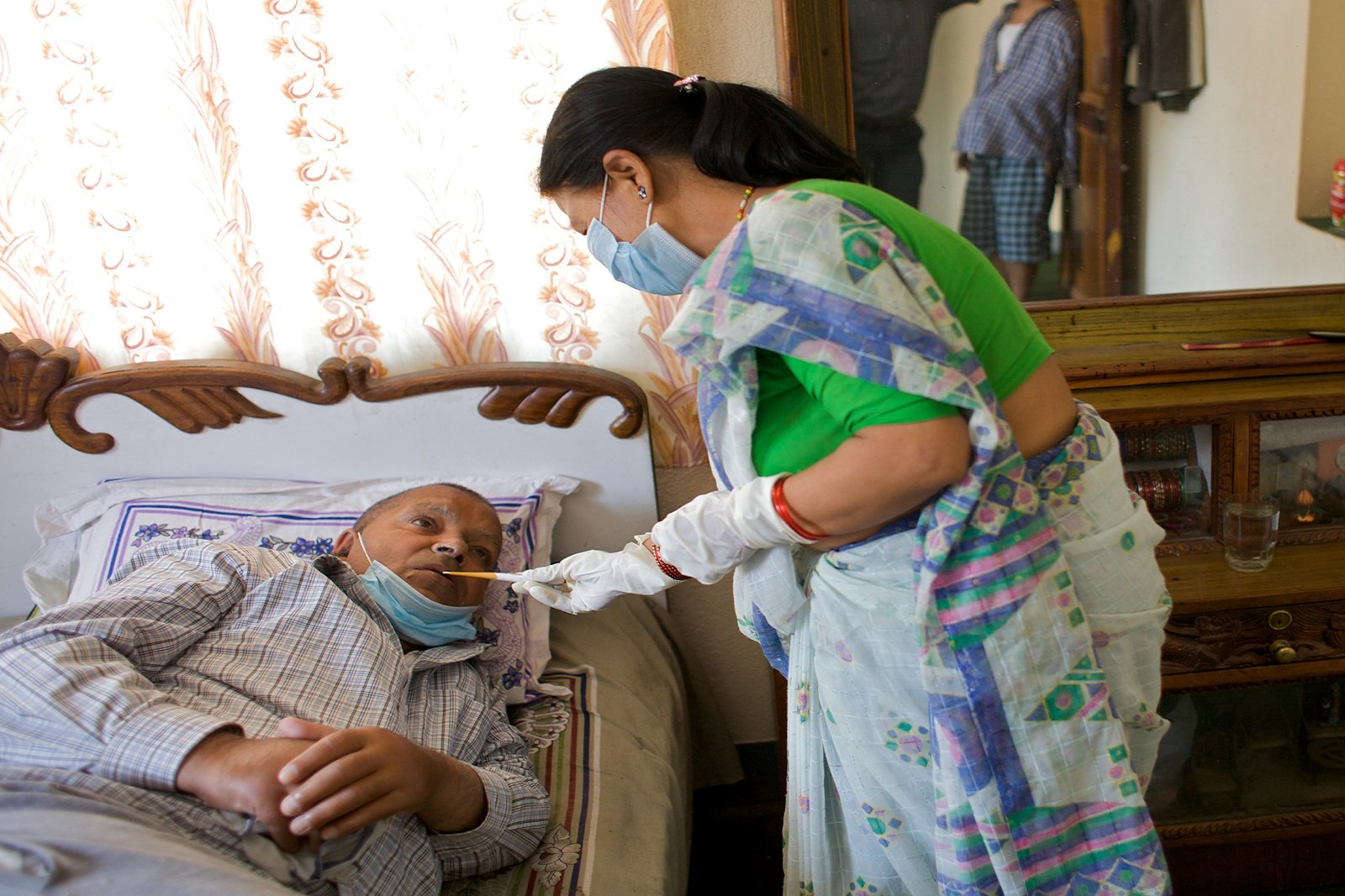 Patient being taken care by health professional