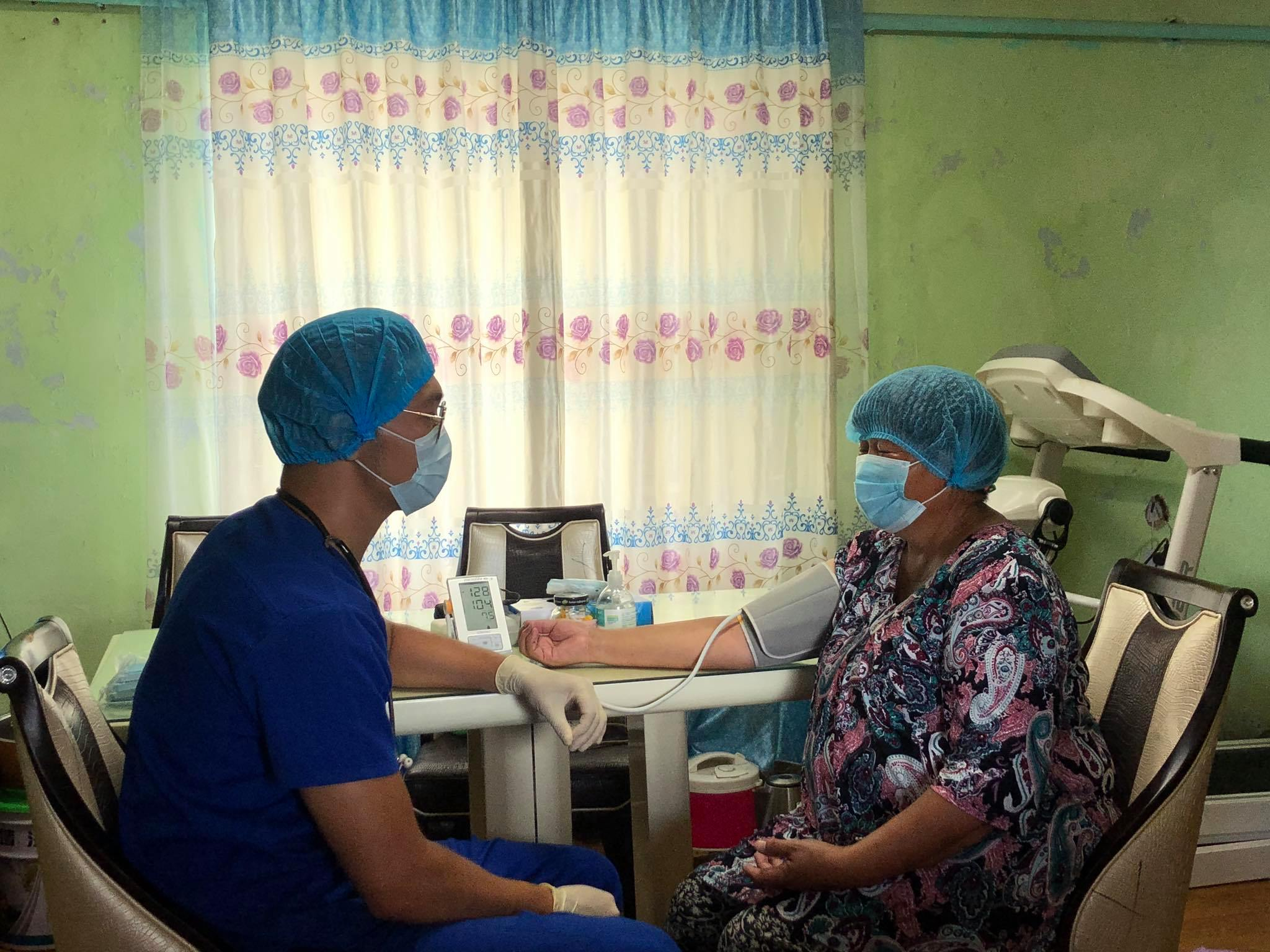 Mongolia - headline image - Dr B.Usukhbayar doing homevisit to his patient Mrs J.Jargal