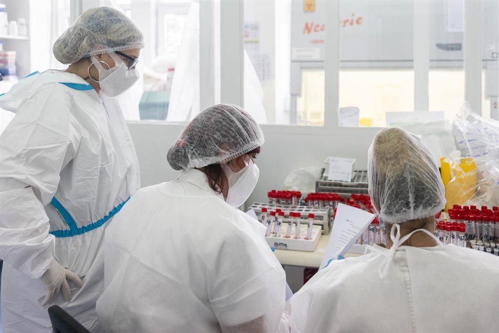 Health workers test saliva samples