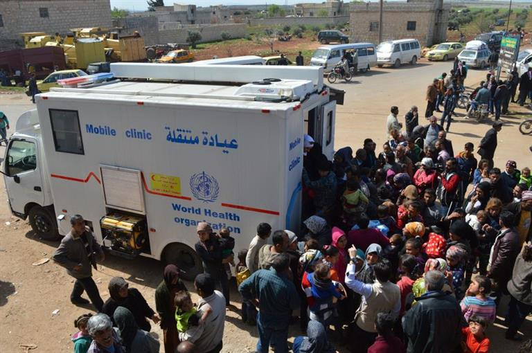 A mobile clinic provided to the Aleppo Directorate of Health provides care to children, women and men displaced from Afrin in March 2018.